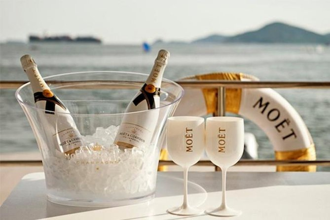 Moët & Chandon beach tour, water mat, swimming snorkeling, beach and caves