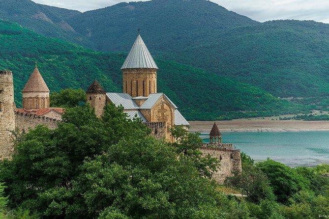 Picturesque tour to Kazbegi. Gergeti Holy Trinity Church.