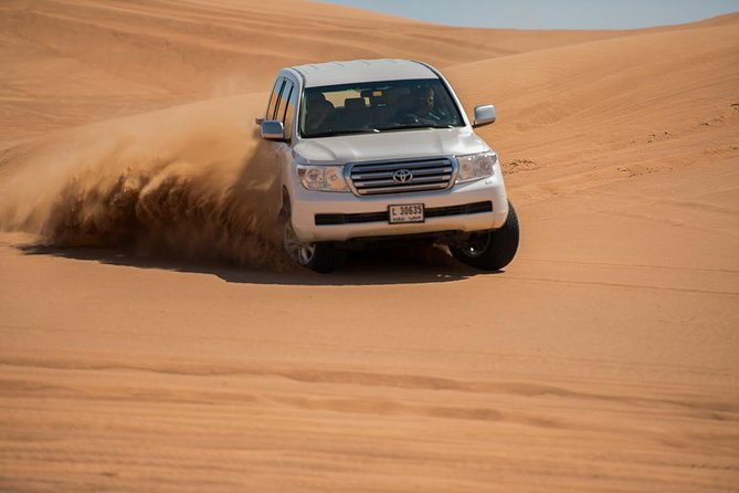 Deluxe Red Dune Desert Safari with BBQ Dinner & Live Entertainments on Sharing