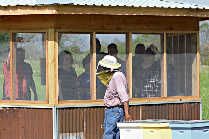 Our beekeepers are experienced and patient teachers. Pictured here is Roosevelt, he has been keeping bees commercially for over 50 years!