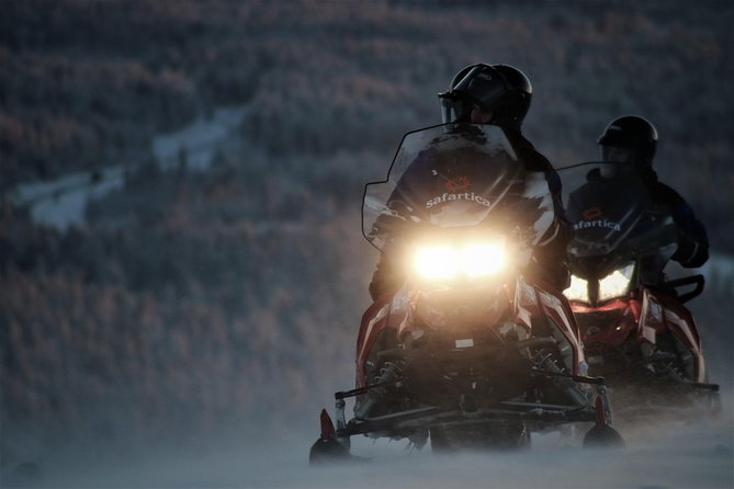 Evening Escape - Snowmobile safari and campfire in Rovaniemi