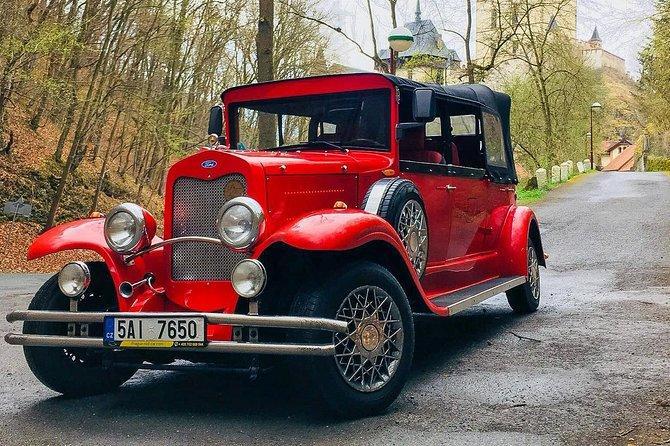 Karlstejn Castle in Vintage Convertible Car
