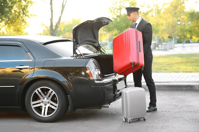 Round trip transfer in private car from-to Prague Airport in Prague City Center