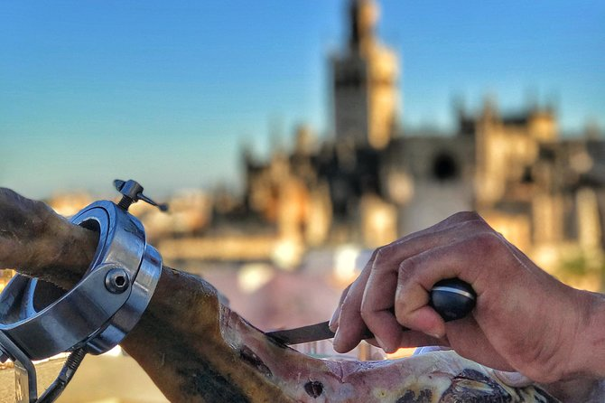 LiveCarving Spanish Ham in hidden rooftop Sevilla downtown photo 10