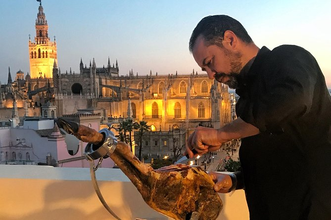 LiveCarving Spanish Ham in hidden rooftop Sevilla downtown photo 1