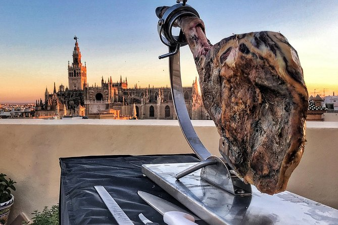 LiveCarving Spanish Ham in hidden rooftop Sevilla downtown photo 8