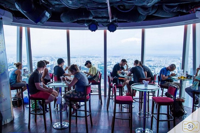 SAIGON ON TOP: Drink at Bitexco Tower and Dinner on Cruise photo 9