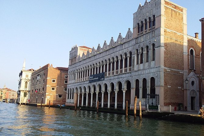 Grand Canal boat tour and Murano glass experience with Hotel pick up