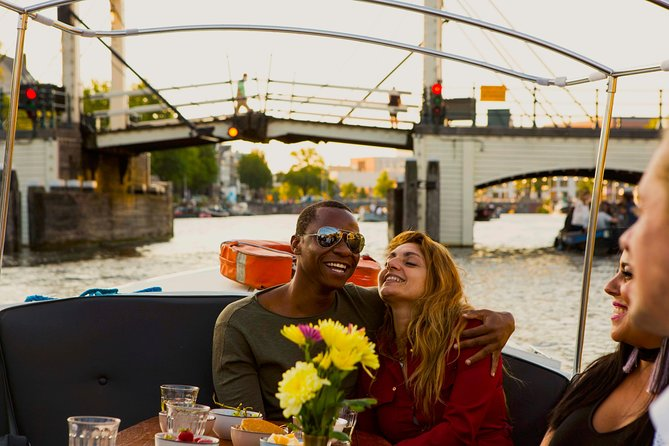 Romantic Amsterdam Canal Tour: Stories of Love and Bubbles