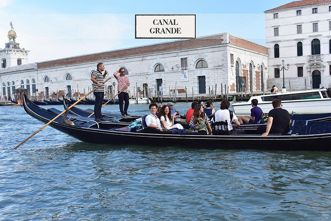 Venice: Gondola ride on Grand Canal with music and dinner
