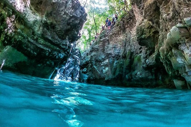 27 Waterfalls With Locals Expert Guides from Damajagua entrace.