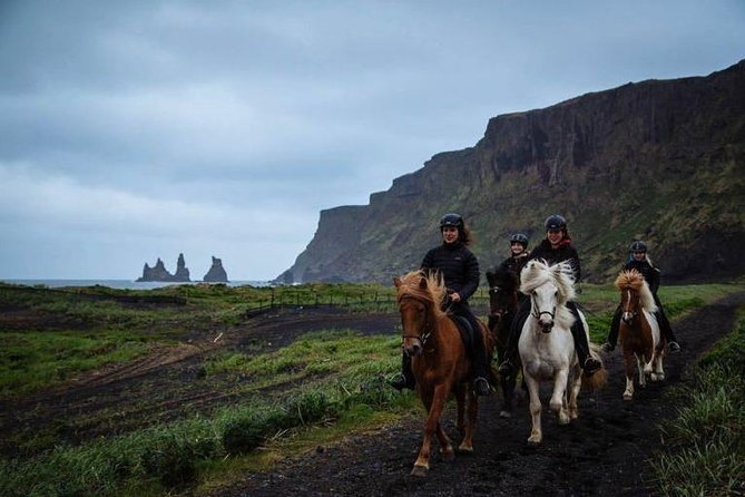 Riding a Horse to Enjoy the Extremely Black Sand Beach and Nature Waterfall