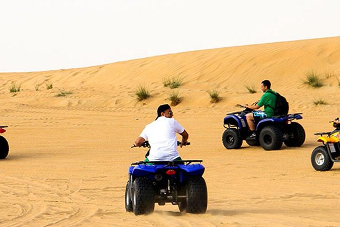 Evening Desert Safari with Quad Bike, Belly Dance, Camel Ride and BBQ Dinner