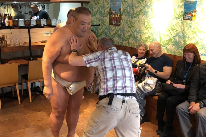Learn Sumo Culture from a Former Wrestler and wear a real sumo belt near Ryogoku photo 2