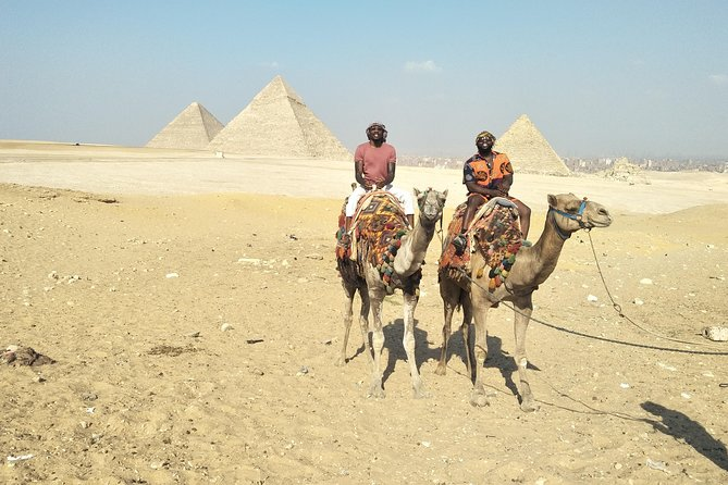 Private day tour Giza Pyramids and Egyptian Museum with camel ride