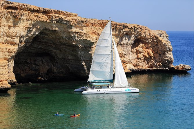 Luxury Catamaran Sail and Snorkel from Muscat