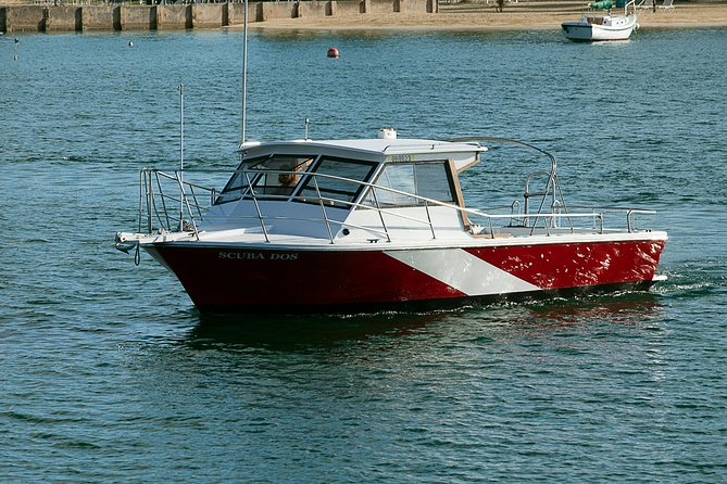 Our west shore dive boat Scuba Dos. Just 15 minutes from the Butler Bay Wrecks and 10 minutes from all the other west end reefs.