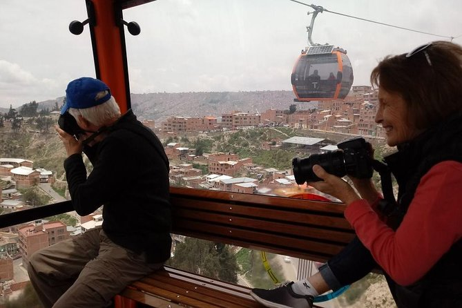 From La Paz: Cable car ride tour with tasting food. photo 1