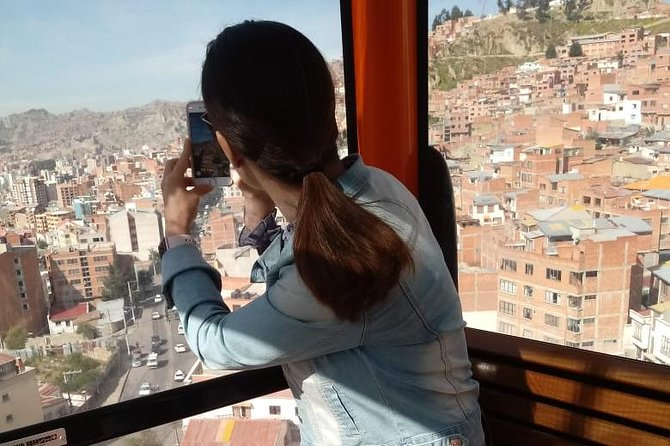 From La Paz: Cable car ride tour with tasting food. photo 3