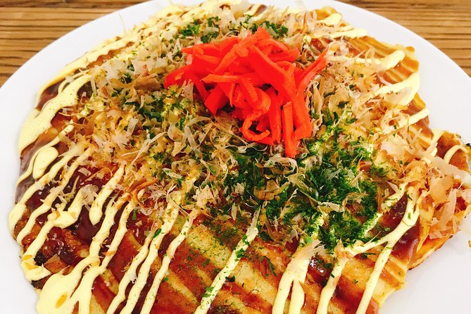 Japanese cooking class for making okonomiyaki while touching the life of Tokyo