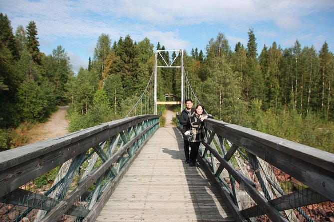 From Rovaniemi: Day Tour Hiking to Auttiköngäs Falls
