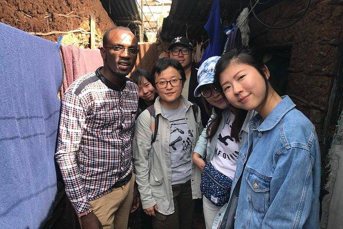 Memorable Daily KIBERA Slums/Toi Market Tour with Locals (2 hours)
