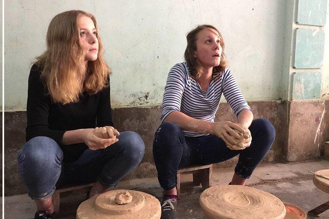 Explore Bat Trang 1000 years ceramic village by car