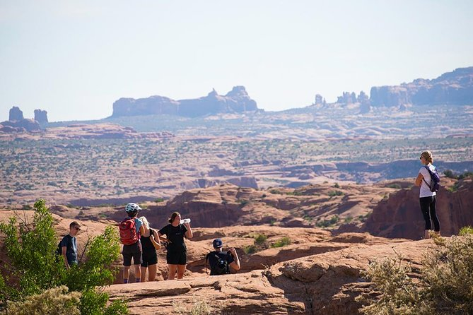 We often get off our bikes and walk over to the edge of an amazing box canyon during the tour.