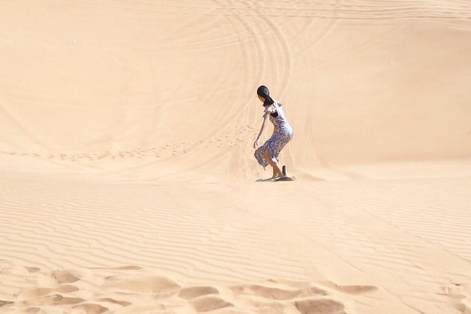 Desert Safari Morning with Camel Ride and Sand Boarding photo 4
