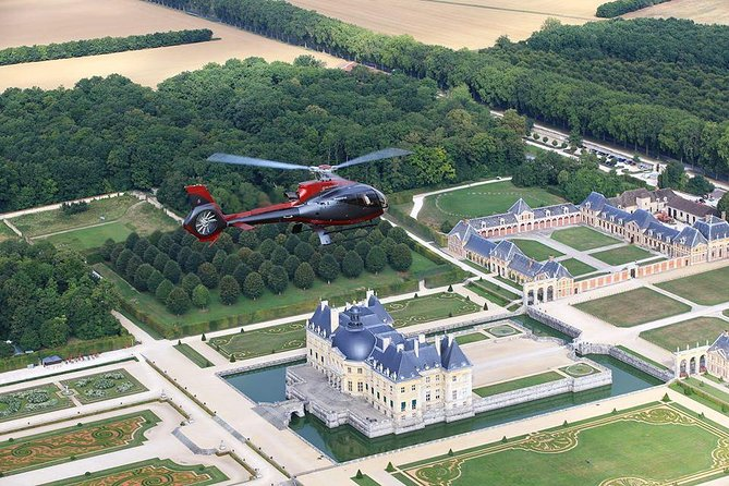 Vaux-le-Vicomte Evening Helicopter Tour from Paris Including Gourmet 3-Course Champagne Dinner and Limousine Return Transport