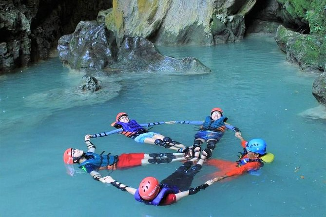 Private Yogyakarta Kalisuci Cave Tubing & Drini Beach Sunset Tour with Guide
