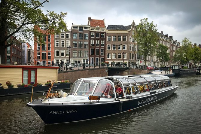 Audio guided tour on a covered boat through the canals of Amsterdam