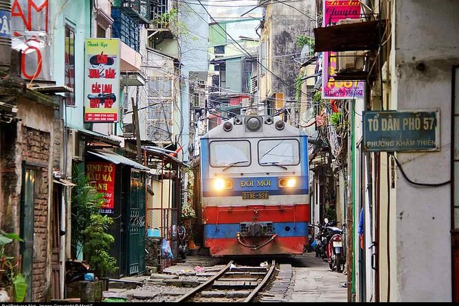 Hanoi Backseat of motorbike tour with railway street