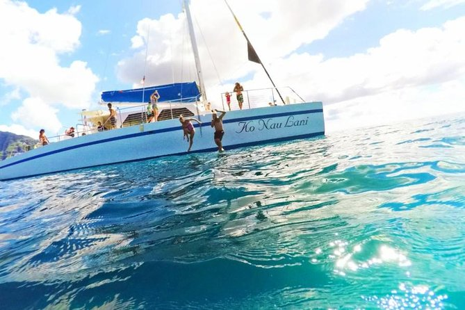 Isla Mujeres tour in a Catamaran with snorkel, open bar, lunch and beach club.