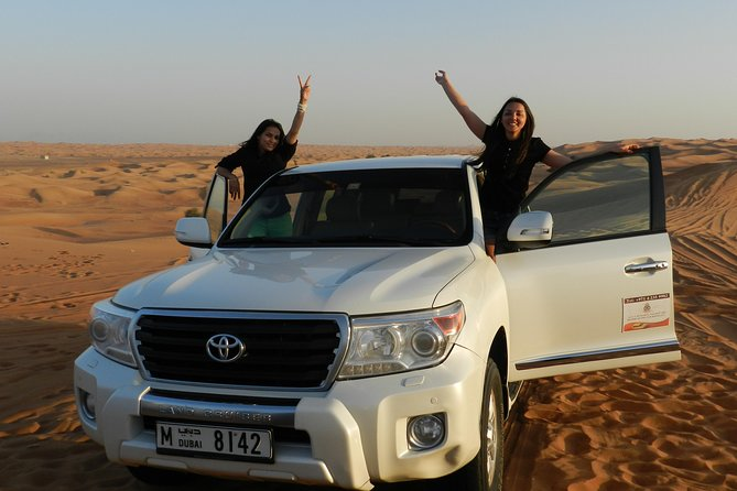 Morning Red Dunes Desert Safari With Camel Ride And Sand Boarding