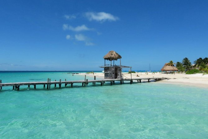 Catamaran tour to Isla Mujeres, Open bar, Lunch, Snorkeling, Beach Club Included
