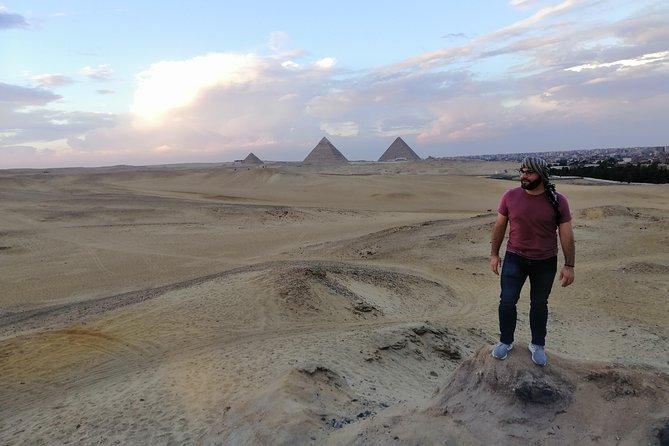 Sunset at Giza pyramids by camel