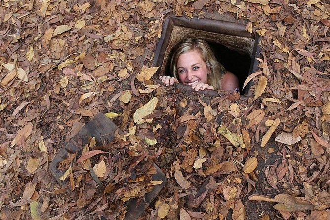 Exploring Cu Chi Tunnel with Pioneer Travel Tour Guide