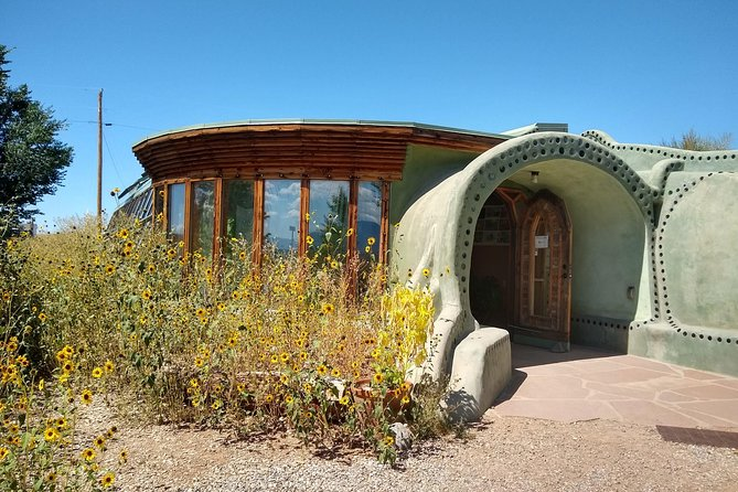 Earthships - totally off-grid and build with discarded tires, bottles, cans.