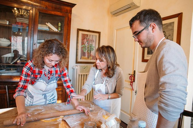 Local market visit and private cooking class at a local's home in Milan