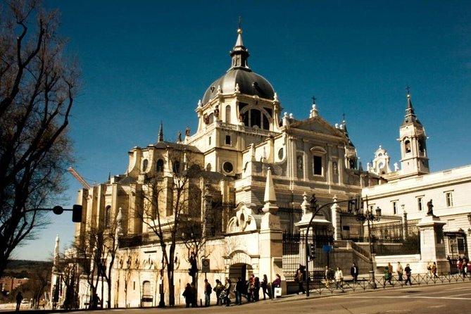 Visit to 5 Catholic Churches + Churros in Madrid