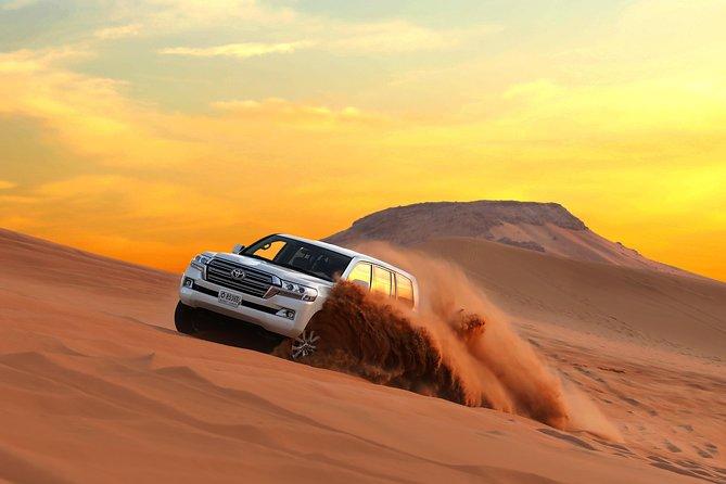 4 hours Dubai: Red Dune Bashing Safari, Sand Surfing & Camel Ride