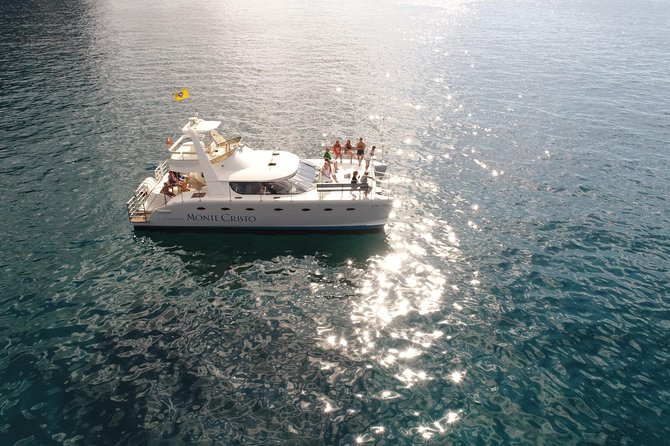 Whale Watching Catamaran Cruise with Snorkeling and Transfers