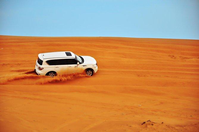 Dubai Red Dunes Safari, passeio de camelo, show de fogo, jantar de churrasco