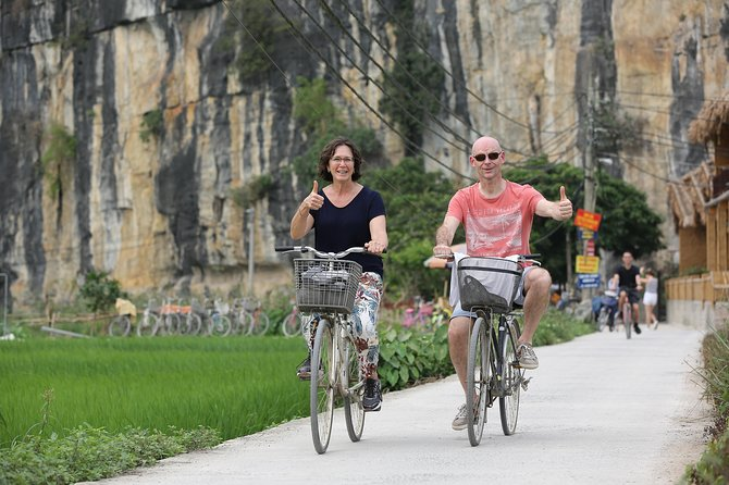 Hoa Lu - Tam Coc Luxury Small group 1D: Limousine bus, biking, boat trip, Lunch
