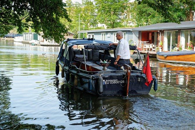 Cruzeiro de barco no Canal de Amsterdã, incluindo petiscos e bebidas