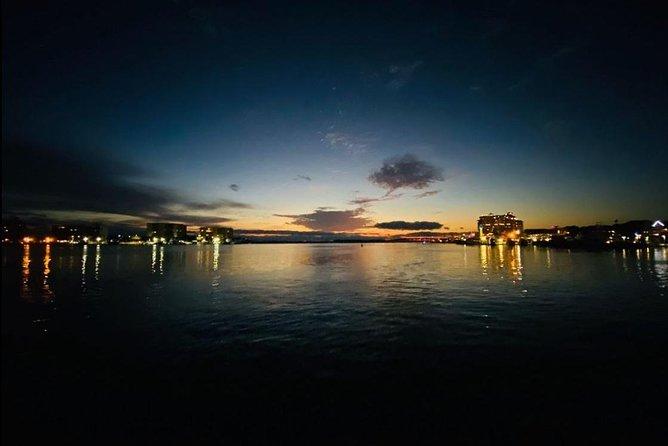 Harbor Lights Tiki Cruise through Destin Harbor
