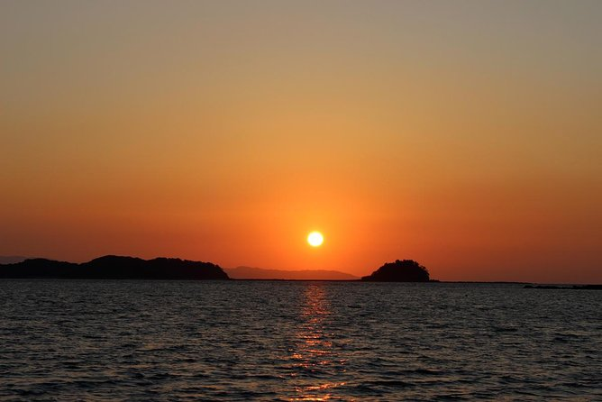 Sunset cruising around the islands while watching the 100 best sunsets in Japan