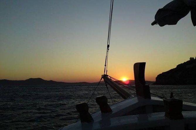 Swim, Fun at Rhenia and Iconic Sunset View!