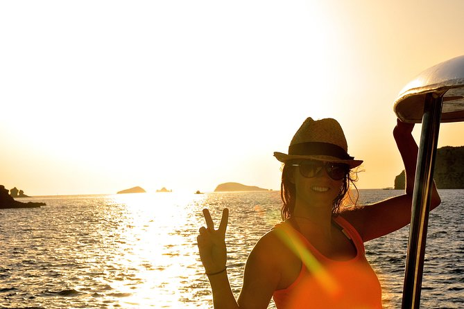 A customer enjoying the Sunset in front of Café del Mar